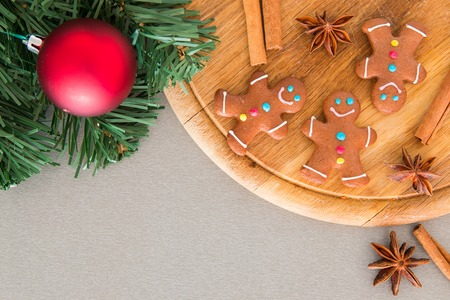 Many gingerbread men on a wooden board for Christmas Stock Photo