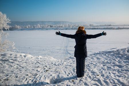 siberia: Girl looking on winter landscape, Siberia, Russia