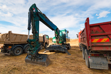 earthmover: Construction Machinery on the territory of beginning construction Stock Photo