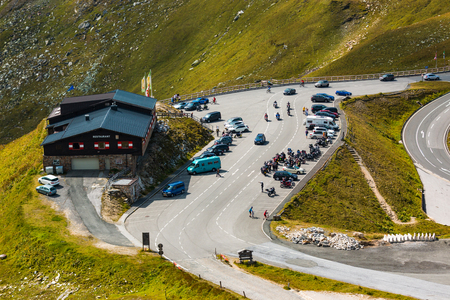 ALPS, AUSTRIA - 27.08.2017: Tourists at the mountain restaurant on the Grossglockner high alpine road in Austria