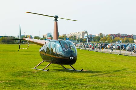 PRAGUE, CZECH REPUBLIC - 9.09.2017: New black helicopter use like business transportation, People in helicopter Editorial