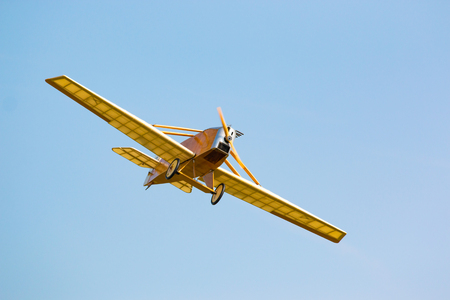 Vintage yellow airplane in blue sky in summer day Stock Photo