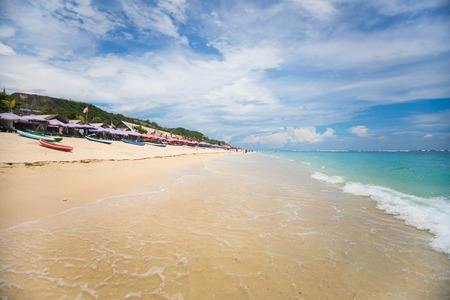 BALI, INDONESIA - 12.11.2017: Transparent and clean sea water with a blurred background of pandawa beach in Bali