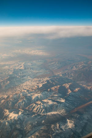 Aerial view of mountain from airplane window, nature background