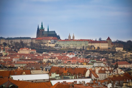 Prague castle and red roofs of old town in evening time, Czech Republic Foto de archivo