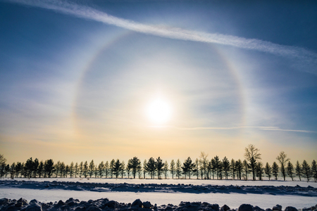 Halo around sun on blue sky in winter time