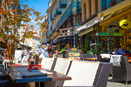 Bucharest, Rumania - 28.04.2018: Tourists in Old Town and Restaurants on Downtown Lipscani Street, one of the most busiest streets of central Bucharest
