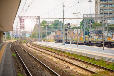 Platform of railway station in sunny day in Rimini, Italy Stock Photo