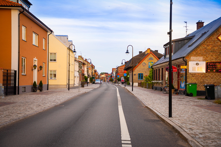 Raa, Sweden - 17.06.2018: Beautiful houses on Raavagen street with no people in evening in small town Raa - old fishing village located in southern Sweden