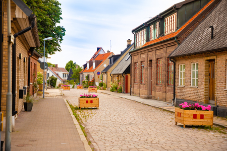 Beautiful houses on Raavagen street with no people in evening in small town Raa - old fishing village located in southern Sweden