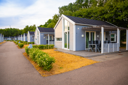 Raa, Sweden - 17.06.2018: Group of similar grey camping cabins in small swedish town Raa