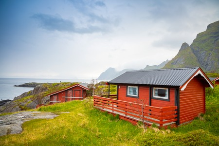 Traditional red camping houses with a beautiful sea view next to village A in lofoten, Norway