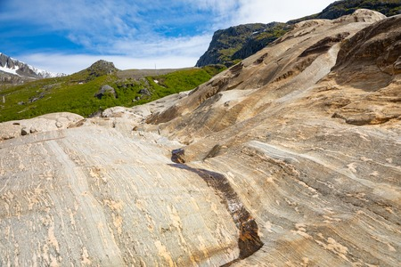 Rock formations near the Svartisen glacier, colorful natural backgroung, Norway