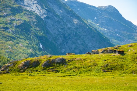 Wooden old houses in mountainous region is on the rise to the mountain Dalsnibba in Norway