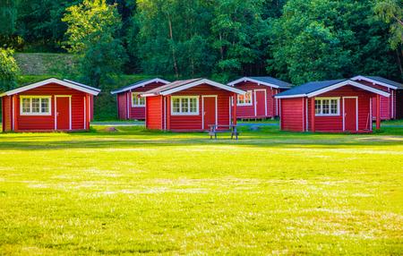 Riksveg, Norway - 25.06.2018: Red camping cabins for travelers in camping Riksveg, Norway