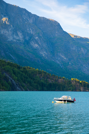 Boat on Oppstrynsvatn lake in the municipality of Stryn in Sogn og Fjordane county,in Norway Stock Photo
