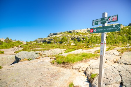 Preikestolen, Norway - 30.06.2018: Signpost showing direction and distance to Preikestolen, or Pulpit Rock on Lysefjord in Norway