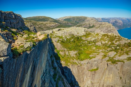 Footpath and Lysefjord, view from Preikestolen in Norway Stock Photo