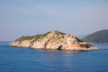 Rt Ostra Light is point extremity of a narrow and rocky peninsula Prevlaka, entrance point of Boka Kotorska in Croatia