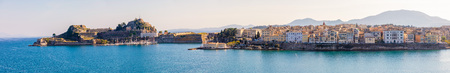 Corfu town in panoramic view from the water in Greece Stock Photo