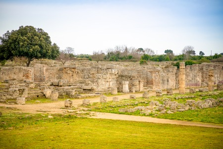 Old ruins of ancient Greek city in Paestum in Italy