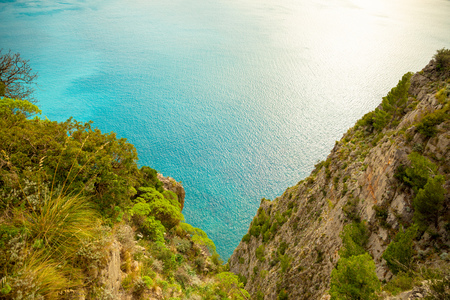 View of turquoise sea water in ravine from Mountain road with sea view near Maratea, Basilicata in Italy Foto de archivo - 119249782