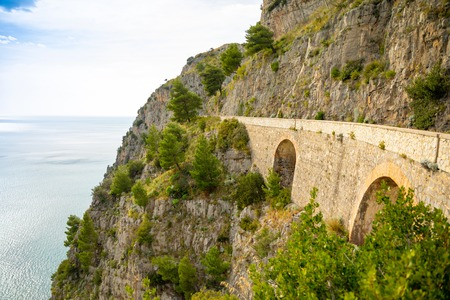 Mountain road with sea view near Maratea, Basilicata in Italy Foto de archivo - 119249786