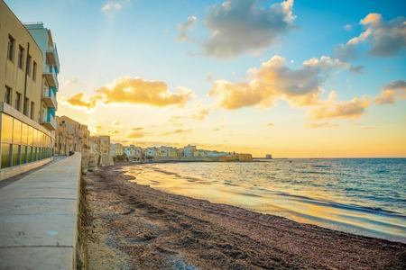 View of seaside of the sicilian city Trapani during sunset in Italy Foto de archivo - 119249818
