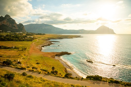 View of mountains and blue sea in the Italian natural reserve or Riserva dello Zingaro at sunset lights in Sicily in Italy Foto de archivo - 119249821
