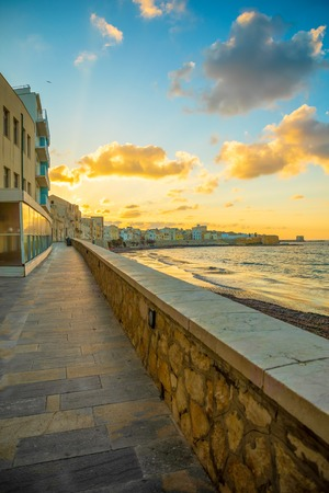 View of seaside of the sicilian city Trapani during sunset in Italy Foto de archivo - 119250030