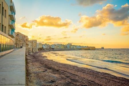 View of seaside of the sicilian city Trapani during sunset in Italy Foto de archivo - 119250041