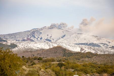 Etna Volcano with smoke in winter, volcano landscape from Catania, Sicily island in Italy Foto de archivo - 119250177