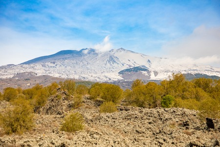 Etna Volcano with smoke in winter, volcano landscape from Catania, Sicily island in Italy Stock Photo