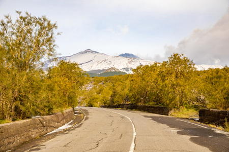 Road to volcano and snow covered Etna Mount, Sicily in Italy Foto de archivo - 119250251