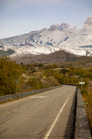 Road to volcano and snow covered Etna Mount, Sicily in Italy Foto de archivo - 119250255