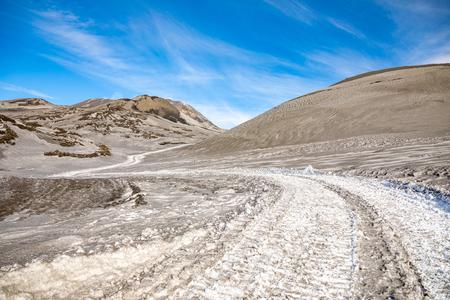 Footpath to Etna Volcano with smoke in winter, volcano landscape in Sicily island, Italy Foto de archivo - 119250257
