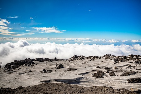 Panoramic view over the clouds from Etna to Catania in Sicily, Italy Foto de archivo - 119250263