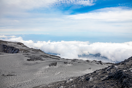 Panoramic view over the clouds from Etna to Catania in Sicily, Italy Foto de archivo - 121409021