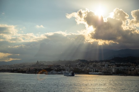 Beautiful view of cityscape and harbor of Messina from ferry in Sicily, Italy Foto de archivo - 121409047
