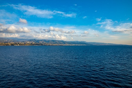 View of Strait of Messina connected Mediterranean and Tyrrhenian sea and Sicilia island background from ferry in Italy Foto de archivo - 121425802