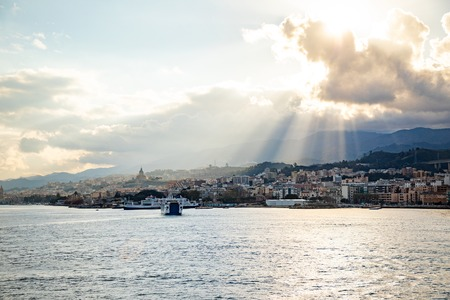 Beautiful view of cityscape and harbor of Messina from ferry in Sicily, Italy Foto de archivo - 121425845