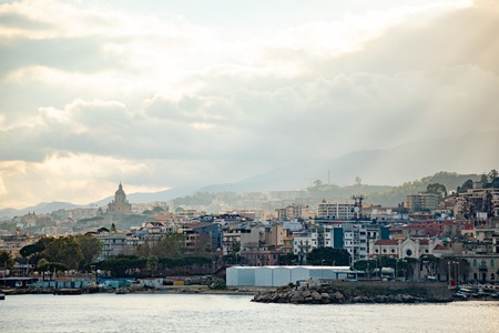 Beautiful view of cityscape and harbor of Messina from ferry in Sicily, Italy Foto de archivo - 121426310