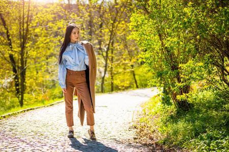 Beautiful young asian woman in spring park in Prague Foto de archivo - 121435846