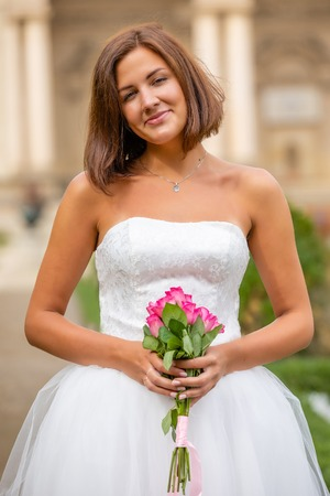 Charming bride in Wallenstein garden in Prague in Czech Republic Foto de archivo - 121436063