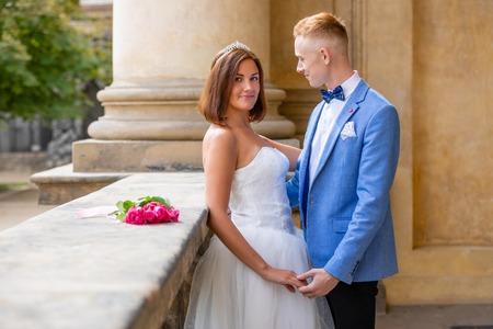 Charming newlywed couple in Wallenstein garden in Prague in Czech Republic