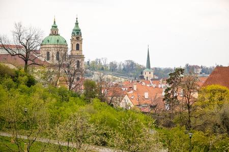 Blooming apple tree in spring Prague Petrin hill with city veiw in Czech Republic Foto de archivo - 121436144