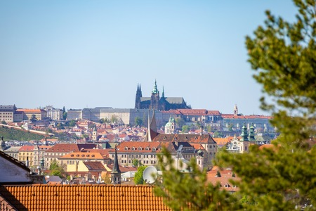 View of Prague Castle over red roof from Vysehrad area at sunset lights, Prague in Czech Republic Foto de archivo - 122019589