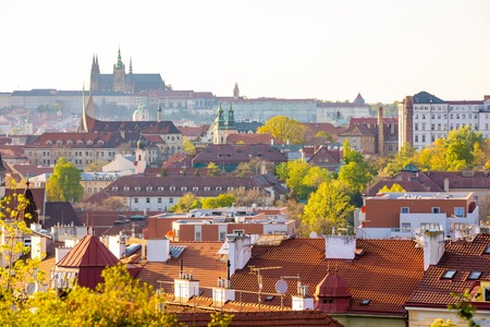 View of Prague Castle over red roof from Vysehrad area at sunset lights, Prague in Czech Republic Foto de archivo - 122019590