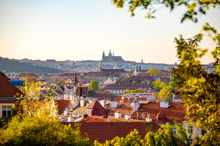 View of Prague Castle over red roof from Vysehrad area at sunset lights, Prague in Czech Republic Foto de archivo - 122019594