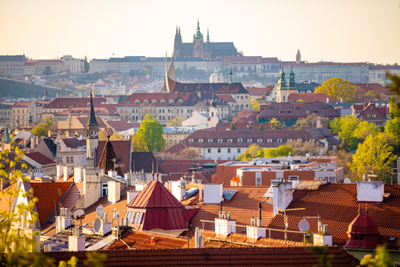 View of Prague Castle over red roof from Vysehrad area at sunset lights, Prague in Czech Republic Foto de archivo - 122019596